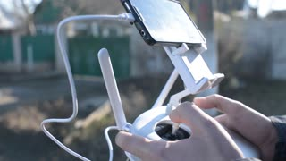 The pilot flying drone control it with a joystick