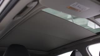 The Sunroof of the new modern Car Nissan close and opens automaticly