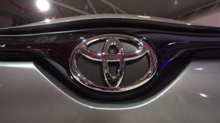 Toyota logo on the bumper of the car