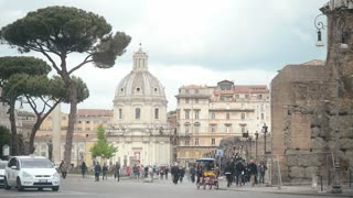 Traffic and pedestrian along the street of the central part of Rome Italy