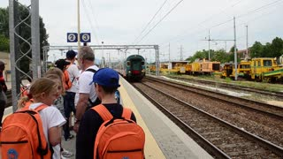 Train arrives at the station with passengers - Italy