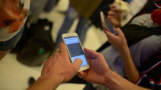 Two Girls chating with Mobile Sell Phones in Hands