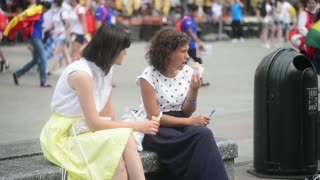 Two Women Eating Ice Cream In The City - Market Square, Krakow Poland