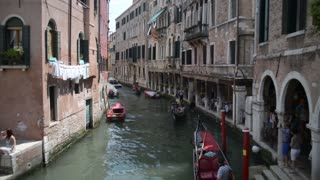 Venice in Summer, streets and canals. The gondola is sailing on the water