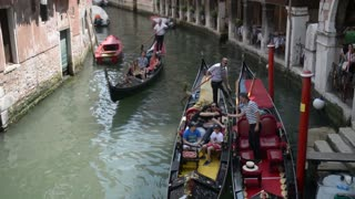Venice in Summer. The gondola is sailing on the water