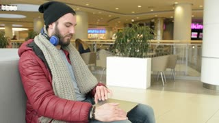 A Man Traveler use Laptop working online outsource at the Airport Terminal