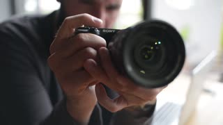 A Man trying to use Photo Camera Sony - close-up
