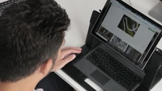 A Man work with Leptop Netbook - browse Photos of Nature