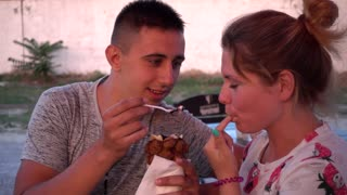 A romantic Evening - Boy feeds his Girlfriend a Dessert from a Spoon