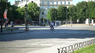 A young girl runs jogging across the street Champs Elysees in Paris