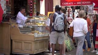 African-american man buys food in the Latin Quarter of Paris