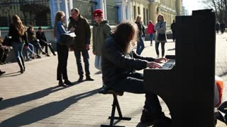 An old Man Hipster playing on a Street Piano - Kiev Ukraine