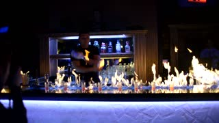 Bartender show performance with fire juggling and alcohol
