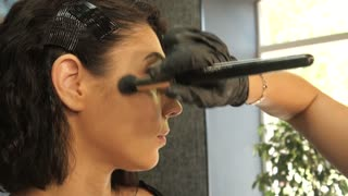 Beautiful Woman's Face and Make-up Procedure in a Beauty Salon