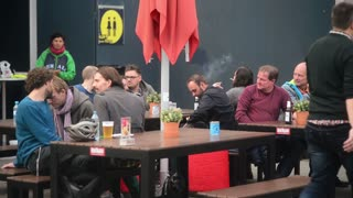 Berlin, Friedrichstrasse - people sitting at tables Cafe Food Festival