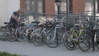 Bicycle Parking - a Man unlock his Bike