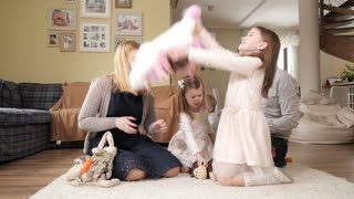 Big Happy Family with Kids play throw up Plush Toys sitting on a Home Floor