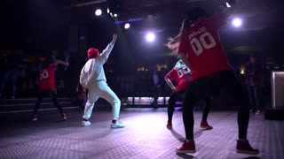 Boy and Girls dancing in synchronized dance Hip-Hop in nightclub