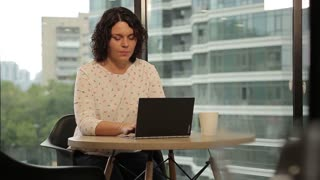 Business Woman Brunette Working With Her Laptop At The Office