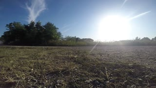Car race show with Dust Clouds rising - GoPro camera against the Sun