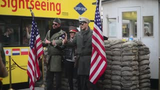 Checkpoint Charlie, Berlin, Tourists make Photo with actors as American Soldiers