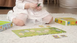 Child Little Kid Girl Playing Paper Cards Game at Home Or Kindergarten