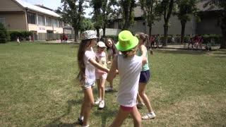 Children Girls having fun run around and smile on the Playground - summer day