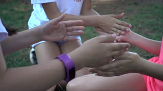 Children Girls on Playground clapping hands counting game
