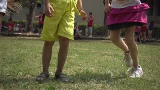 Children Kids dance legs on the Playground - Summer Day