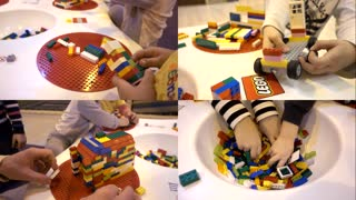 Children kids playing with Lego construction blocks