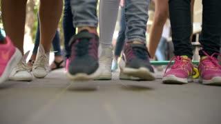 Children Legs dancing on the street near Ice Cream Shop