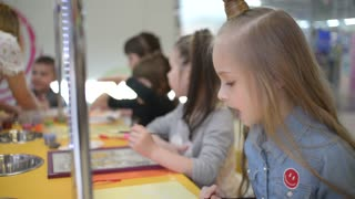 Children Painting And Drawing with colorful Sand - Art Therapy