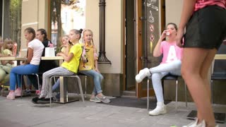 Children ride on Skateboards and Bicycle come for Ice Cream Shop