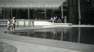 Children Run along the Fountain on Piazza Gae Aulenti Milan Business Center