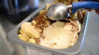 Close Up Banana Ice Cream Scooping Out Of Container