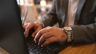 Close-up indian Businessman use Laptop in a cozy Cafe for outsource Work