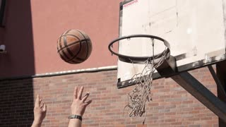 closeup of ball going into basket street basketball game stock