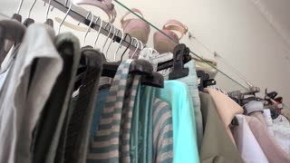Clothes on the Trempels in a Store - shopping