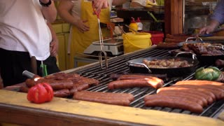 Cook grilled Meat roasting on a Street Food Festival
