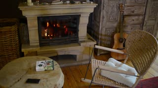 Cozy living room interior, a Fireplace, a Chair and a Table
