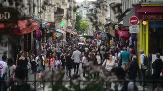 Crowd of People walking down the Street on Montmartre Paris