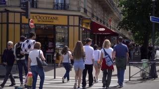 Crowd of tourists walking Street in Latin Quarter in City Paris