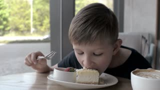 Cute Kid In Cafe, Boy Eating Sweet Pieces Of Cake