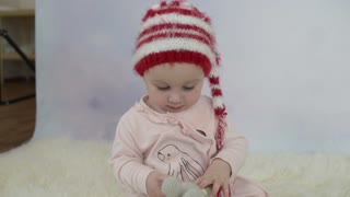 Cute little Baby Girl posing on a Photo Session in Studio