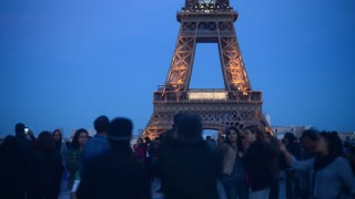 Eiffel Tour lights up crowd of people make photo with Mobile phone - night Paris