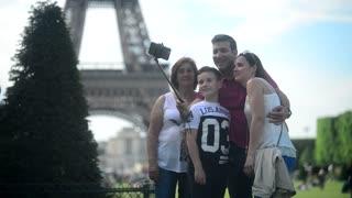 Family make Selfie Photo with Mobile Cell Phone on Champs-de-Mars Paris Eiffel