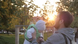 Father Play Toss Up And hold Little Child Son in a Park