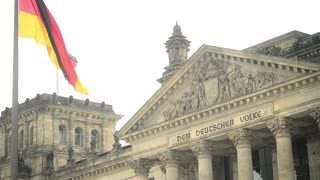 Flag of Germany near the Reichstag building - cloudy Day
