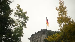 Flag of Germany on the Reichstag building - cloudy Day