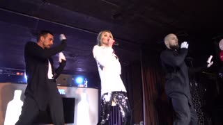Girl and two Boys singing dancing band on stage Hip-Hop in nightclub